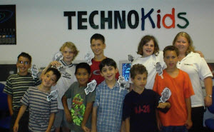 Children enjoy completing the computer camp activities.