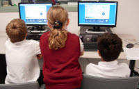 Students teach each other their newly acquired Internet skills