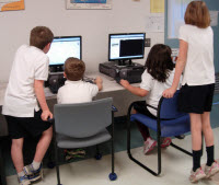 Students in junior grades learn Internet skills.